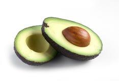 A fresh avocado cut in half Royalty Free Stock Photos