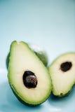 Fresh avocado cut in half Royalty Free Stock Image