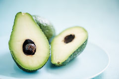 Fresh avocado cut in half Stock Photography