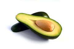 Fresh avocado cut in half Royalty Free Stock Photography