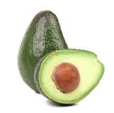 Fresh avocado cut in half. Stock Photos