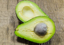 Fresh avocado cut in half Royalty Free Stock Photography