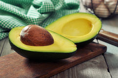 Fresh avocado on cutting board Royalty Free Stock Photo