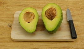 Fresh avocado on cutting board Royalty Free Stock Image