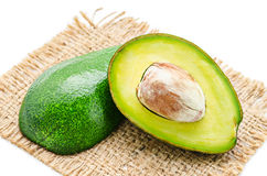 Fresh avocado fruits cit in half. Royalty Free Stock Images