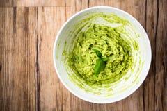 Fresh avocado guacamole on rice bred Stock Photos