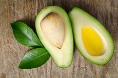 Fresh avocado and half of avocado like a bowl for oil Stock Images