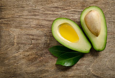 Fresh avocado and half of avocado like a bowl for oil Royalty Free Stock Image