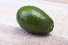 Fresh Avocado isolated on wooden background. Royalty Free Stock Photography
