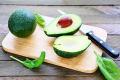 Fresh avocado on a kitchen board royalty free stock photos