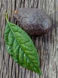 Fresh avocado with leaf put on wooden board Stock Photo