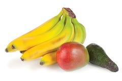 Fresh avocado, mango and bunch of bananas Stock Photos