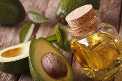 Fresh avocado oil in a glass bottle close-up. Horizontal Royalty Free Stock Photo