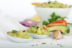 Fresh avocado sauce guacamole in white spoons Royalty Free Stock Photography