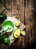 Fresh avocado sauce, lime and herbs. royalty free stock image