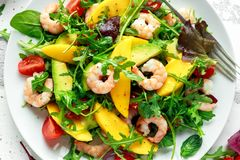 Free Fresh Avocado, Shrimps, Mango Salad With Lettuce Green Mix, Cherry Tomatoes, Herbs And Olive Oil, Lemon Dressing Stock Image - 112952841