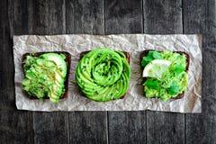 Fresh avocado toasts Royalty Free Stock Photo