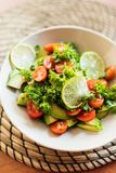 Fresh avocado and tomatoes salad Stock Photo