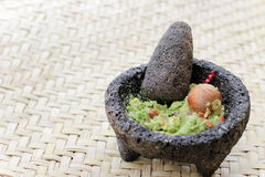 Fresh avocado on traditonal stone molcajete Stock Photos