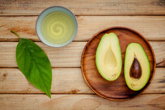 Fresh avocado on wooden background. Organic avocado healthy food Royalty Free Stock Photos