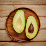 Fresh avocado on wooden background. Organic avocado healthy food Royalty Free Stock Image