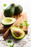 Fresh avocado on wooden board Stock Photography