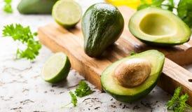 Fresh avocado on wooden board Stock Photos