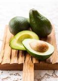 Fresh avocado on wooden board Royalty Free Stock Image