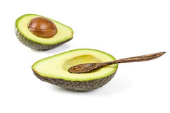 Fresh avocado with wooden spoon isolated Stock Photo