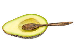 Fresh avocado with wooden spoon isolated Royalty Free Stock Images
