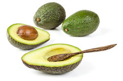 Fresh avocado with wooden spoon isolated Stock Photography