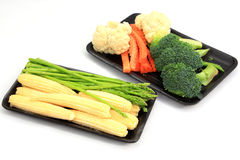 Fresh Baby corn and Asparagus with set vegetables. On white background Stock Photo