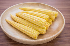 Fresh baby corn on wooden plate Royalty Free Stock Photo