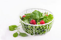 Fresh baby spinach and strawberries Royalty Free Stock Image