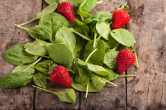 fresh baby spinach and strawberries Royalty Free Stock Photos