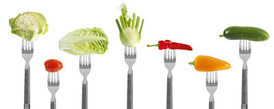 Fresh baby vegetables on forks Stock Photography