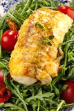 Fresh backed codfish filet on white table. stock photos