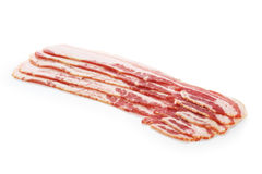 Fresh bacon strips. Isolated on white background Stock Photos