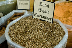 Fresh bag of indian coriander seeds. Bag of fresh whole coriander seed from India ready for sale on a food market Stock Photos