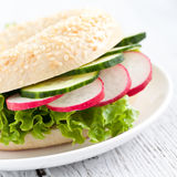 Fresh bagel with salad Stock Photography