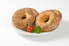 Fresh bagels with seeds Stock Photo