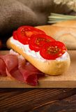 Fresh baguete with cottage cheese and tomato slices Stock Photography