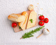 Fresh baguette with butter and vegetables Royalty Free Stock Image