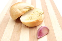 Fresh baguette with garlic butter on wooden cutting board Royalty Free Stock Images