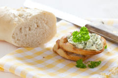 Fresh baguette with herb butter Royalty Free Stock Images
