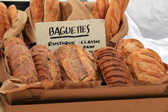 Fresh baguettes and bread on display at market Royalty Free Stock Photos
