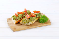 Fresh baguettes with guacamole Stock Photos