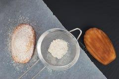 Fresh bake mini cake madeleines icing sugar on top Royalty Free Stock Photography
