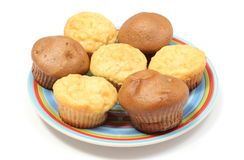 Fresh baked apple and coffee muffins on colorful plate Royalty Free Stock Images