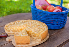 Fresh  apple pie and fruits on wooden table Royalty Free Stock Photography